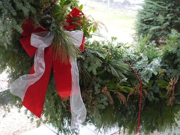 One of my favorite traditions is making my own evergreen wreath for Christmas to hang on our massive stone chimney. Learn how to make one!