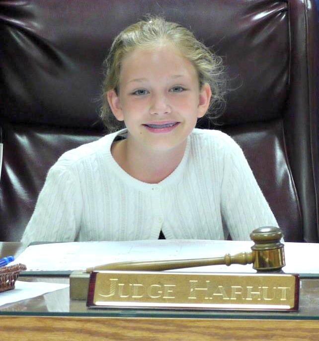 Bella in the judges seat on adoption day.