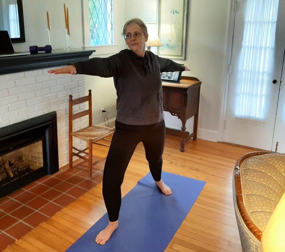 woman taking Silver&Fit yoga class