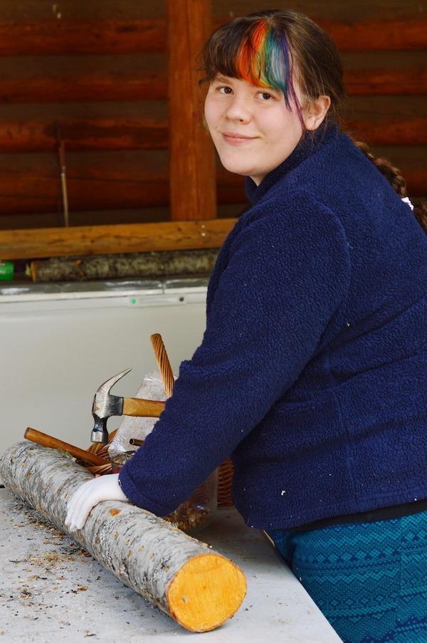 Author Sarah Dalziel Kirchhevel preparing a log for inoculation.